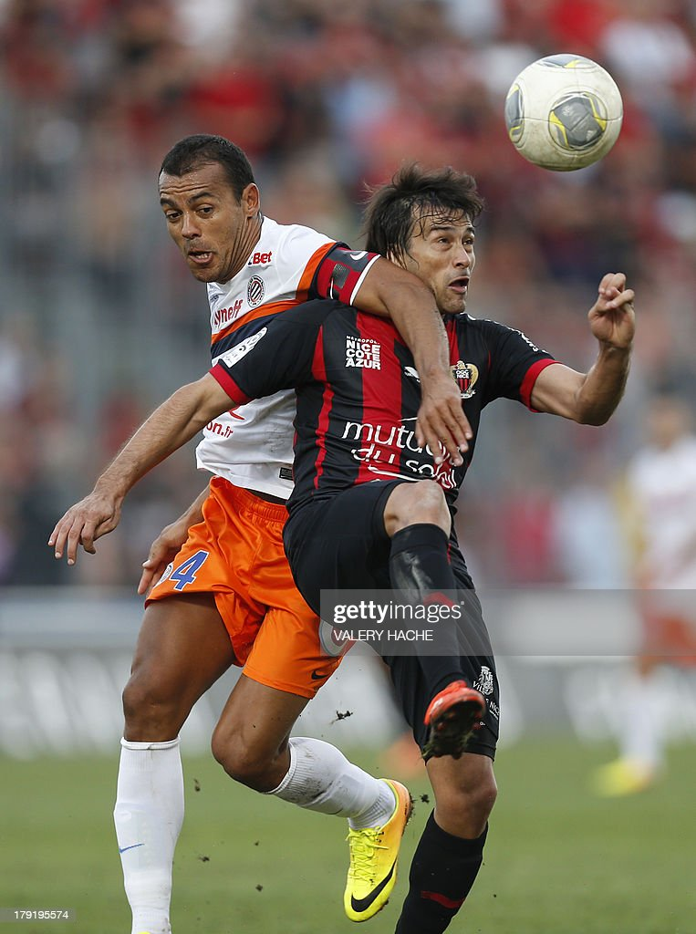 Nice's Argentinian forward Dario Cvitanich (R) vies with Montpellier's Brazilian defender Vitorino Hilton (L) during the French L1 football match between Nice and Montpellier on September 1, 2013 at the Ray stadium in Nice, southeastern France.