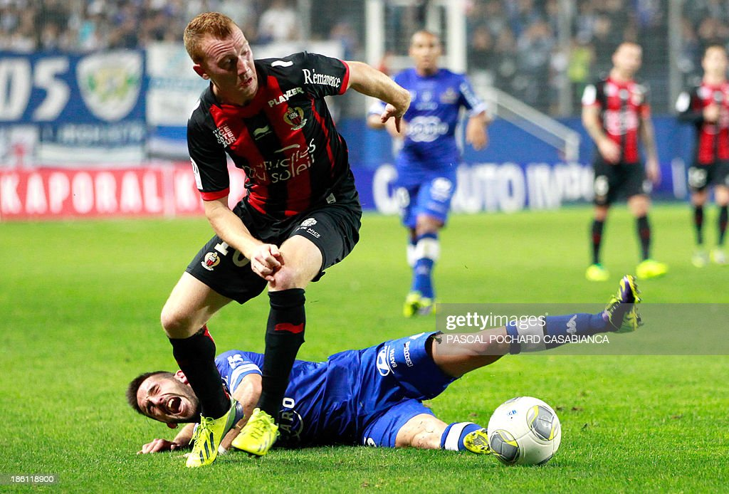 Nice's Belgian midfielder Christian Bruls (top) vies with Bastia's French defender Julian Palmieri during the French L1 football match Bastia (SCB) against Nice (OGC) in the Armand Cesari stadium in Bastia, Corsica, on October 26, 2013.