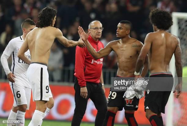 Nice's Brazilian defender Dalbert Henrique and Paris SaintGermain's Uruguayan forward Edinson Cavani react at the end of the French L1 football match...