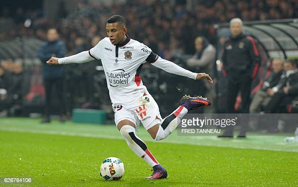 Nice's Brazilian defender Dalbert Henrique dribbles during the French L1 football match Guingamp against Nice on November 30 2016 at the Roudourou...