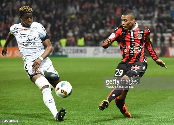 Nice's Brazilian defender Dalbert Henrique kicks the ball past Montpellier's French defender Nordi Mukiele during the French L1 football match OGC...