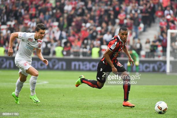 Nice's Brazilian defender Dalbert Henrique outruns Nancy's French defender Joffrey Cuffaut during the French L1 football match OGC Nice vs AS...