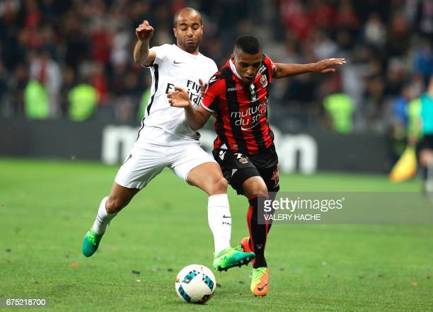 Nice's Brazilian defender Dalbert Henrique vies with Paris SaintGermain's Brazilian midfielder Lucas Moura during the French L1 football match Nice...