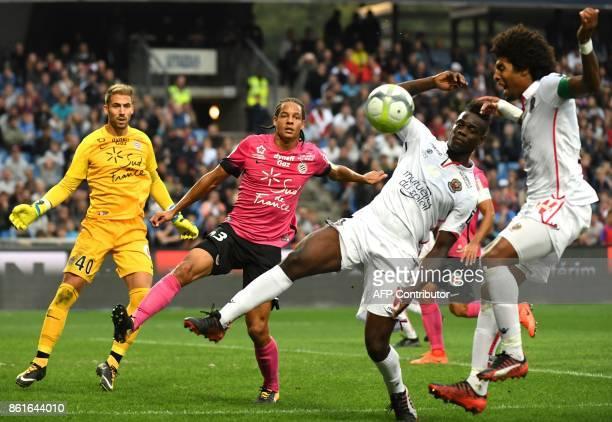 Nice's Brazilian defender Dante and Nice's Italian forward Mario Balotelli vie with Montpellier's French defender Daniel Congre and Montpellier's...