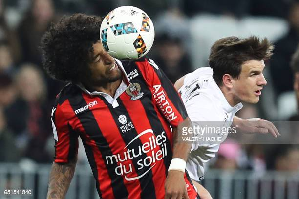 Nice's Brazilian defender Dante vies with Caen's Croatian forward Ivan Santini during the French L1 football match Nice vs Caen on March 10 2017 at...