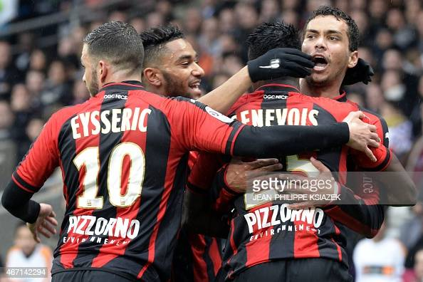 Nice's Brazilian midfielder Carlos Eduardo celebrates with teammates after scoring a goal during the French L1 football match between Lyon and Nice...