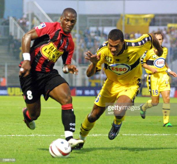 Nice's defener Noe Paramot fights for the ball with Sochaux's striker PierreAlain Frau during their French first league soccer match at the Stade du...
