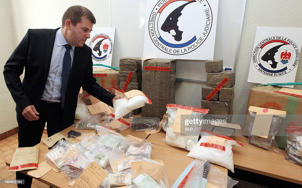 Nice's Divisional Police Commissioner Philippe Frizon presents 4kg of Cocaine, one of heroin and 250kg of cannabis seized during the dismantling of a drug traffic after an inquiry by the Inter region police direction (DIPJ) of Marseille, on September 17, 2013 in Nice.