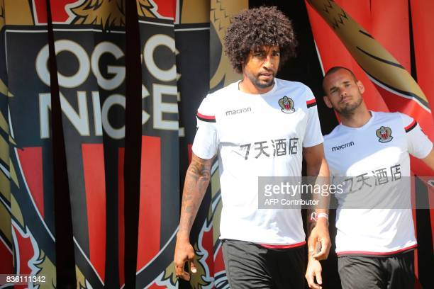 Nice's Dutch midfielder Wesley Sneijder and Nice's Brazilian defender Dante arrive to attend a training session on the eve of the UEFA Champions...