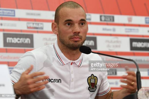 Nice's football club new signing Dutch midfielder Wesley Sneijder gestures during a press conference on August 8 2017 at the Allianz Riviera stadium...