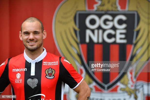 Nice's football club new signing Dutch midfielder Wesley Sneijder poses during a press conference on August 8 2017 at the Allianz Riviera stadium in...