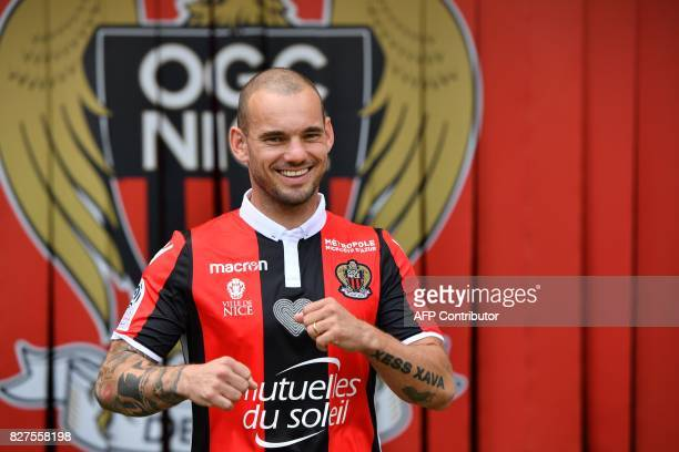 Nice's football club new signing Dutch midfielder Wesley Sneijder gestures as he poses on August 8 2017 at the Allianz Riviera stadium in Nice...