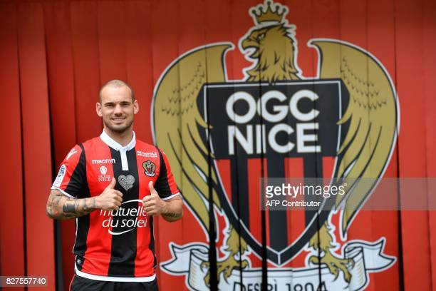 TOPSHOT Nice's football club new signing Dutch midfielder Wesley Sneijder poses on August 8 2017 at the Allianz Riviera stadium in Nice southeastern...