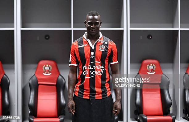TOPSHOT Nice's football club new signing Italian forward Mario Balotelli poses on September 2 2016 at the Allianz Riviera stadium in Nice...