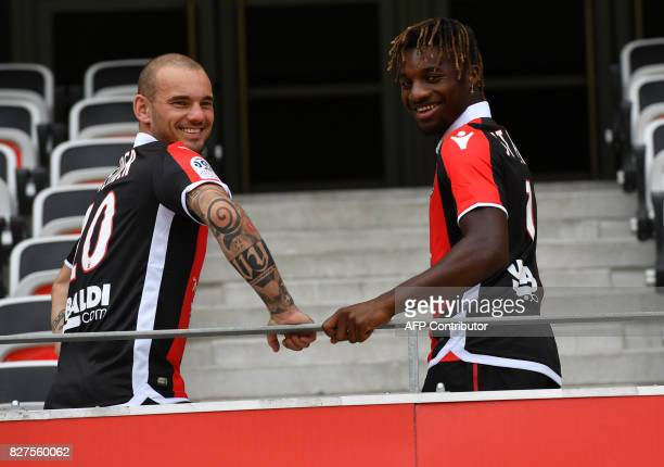 Nice's football club new signings Dutch midfielder Wesley Sneijder and French midfielder Allan SaintMaximin pose on August 8 2017 at the Allianz...