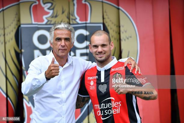 Nice's football club new signings Dutch midfielder Wesley Sneijder and Nice's football club French president JeanPierre Rivere pose on August 8 2017...