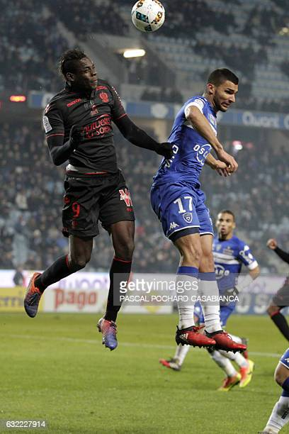 Nice's forward Mario Balotelli vies with Bastia's French defender Lindsay Rose during the L1 football match between Bastia and Nice on January 20...