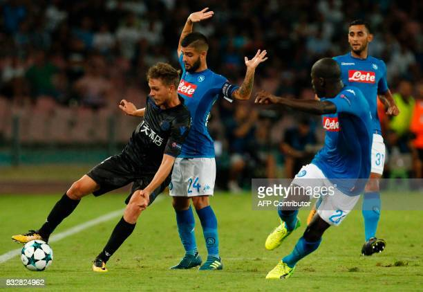 Nice's French defender Arnaud Souquet fights for the ball with Napoli's Italian forward Lorenzo Insigne near Napoli's French defender Kalidou...