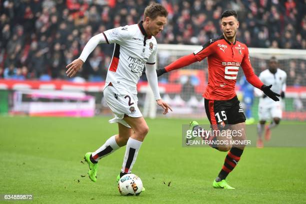 Nice's French defender Arnaud Souquet vies for the ball with Rennes'Algeria defender Ramy Bensebaini during the French L1 football match between...