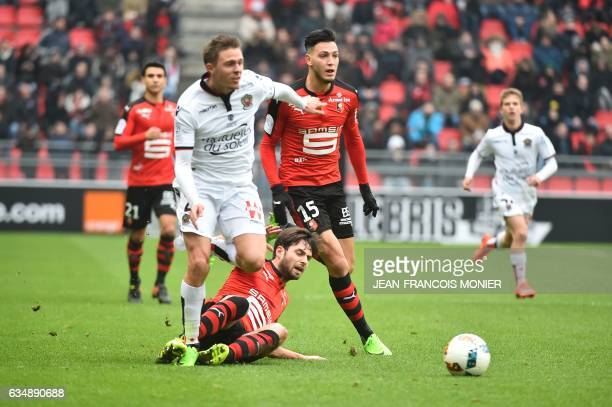 Nice's French defender Arnaud Souquet vies for the ball with Rennes' French midfielder Sanjin Prcic and Rennes'Algeria defender Ramy Bensebaini...
