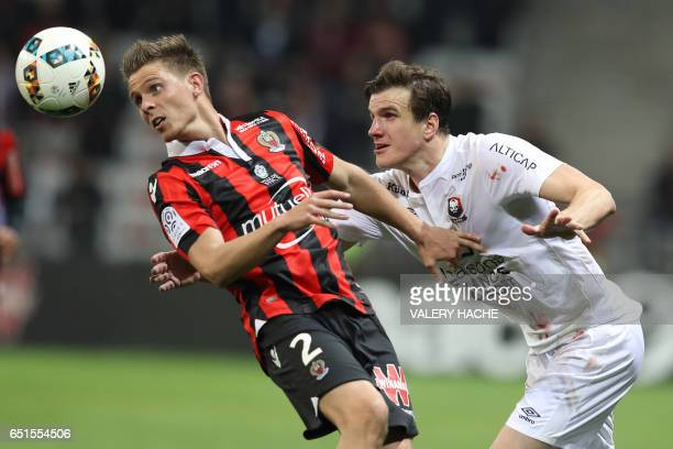 Nice's French defender Arnaud Souquet vies with Caen's Croatian forward Ivan Santini during the French L1 football match Nice vs Caen on March 10...