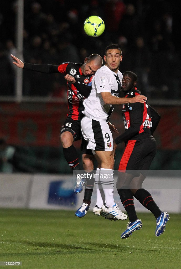Nice's French defender Kevin Gomis (R) and Nice's French midfielder Didier Digard (L) vie with Rennes' French forward Mevlut Erding (C) on December 11, 2012 at the Ray stadium in Nice, southestern France.