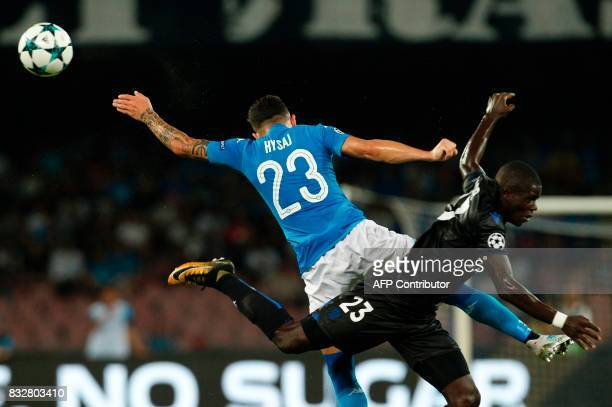 Nice's French defender Malang Sarr fights for the ball with Napoli's Albanian defender Elseid Hysaj during the UEFA Champions League Play Off first...