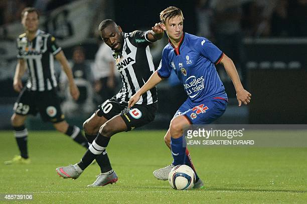 Nice's French defender Olivier Boscagli vies with Angers' French forward Gilles Sunu during the French L1 football match between Angers and Nice on...