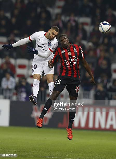 Nice's French defender Romain Genevois and Paris SaintGermain's French defender Layvin Kurzawa go for a header during the French L1 football match...
