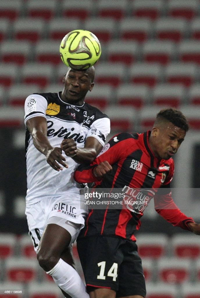 Nice's French forward Alassa Plea (R) vies with Guingamp's French Mauritanian midfielder <a gi-track='captionPersonalityLinkClicked' href=/galleries/search?phrase=Younousse+Sankhare&family=editorial&specificpeople=4436540 ng-click='$event.stopPropagation()'>Younousse Sankhare</a> (L) during the French L1 football match Nice vs Guingamp on March 13, 2015, at the Allianz Riviera stadium in Nice, southeastern France.