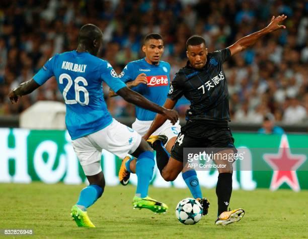 Nice's French forward Alassane Plea kicks the ball next to Napoli's French defender Kalidou Koulibaly and Napoli's Algerian defender Faouzi Ghoulam...