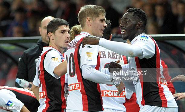 Nice's French forward Alexandre Mendy celebrates with his teammate defender Maxime Le Marchand after scoring during the French Ligue Cup football...