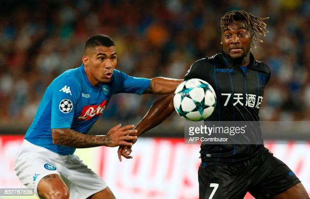 Nice's French forward Allan SaintMaximin fights for the ball with Napoli's Algerian defender Faouzi Ghoulam during the UEFA Champions League Play Off...
