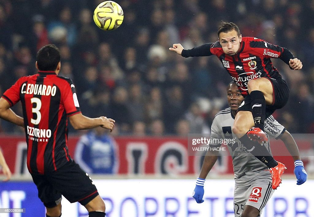Nice's French forward Eric Bautheac (R) jumps for the ball during the French L1 football match between Nice (OGCN) and Marseille (OM) on Januay 23, 2015 at the Allianz Riviera stadium in Nice, southeastern France.