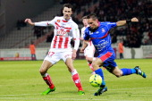 Nice's French forward Eric Bautheac vies with Ajaccio's French defender Yohan Poulard during the French Ligue1 football match Ajaccio vs Nice in the...