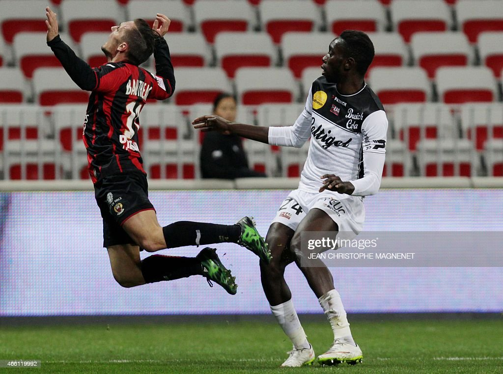 Nice's French forward Eric Bautheac (L) vies with Guingamp's french midfielder <a gi-track='captionPersonalityLinkClicked' href=/galleries/search?phrase=Sambou+Yatabare&family=editorial&specificpeople=5747366 ng-click='$event.stopPropagation()'>Sambou Yatabare</a> (R) during the French L1 football match between Nice and Guingamp on March 13, 2015, at the Allianz Riviera stadium in Nice, southeastern France.