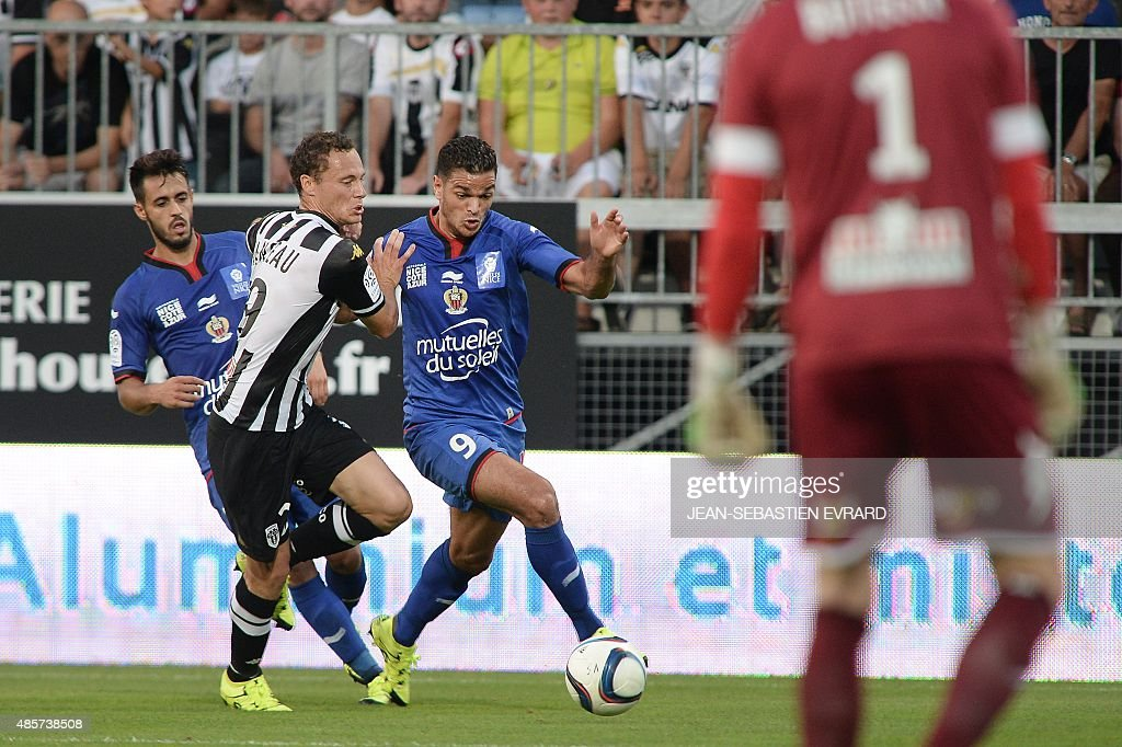 Nice's French forward Hatem Ben Arfa vies with Angers' French midfielder Vincent Manceau during the French L1 football match between Angers and Nice...