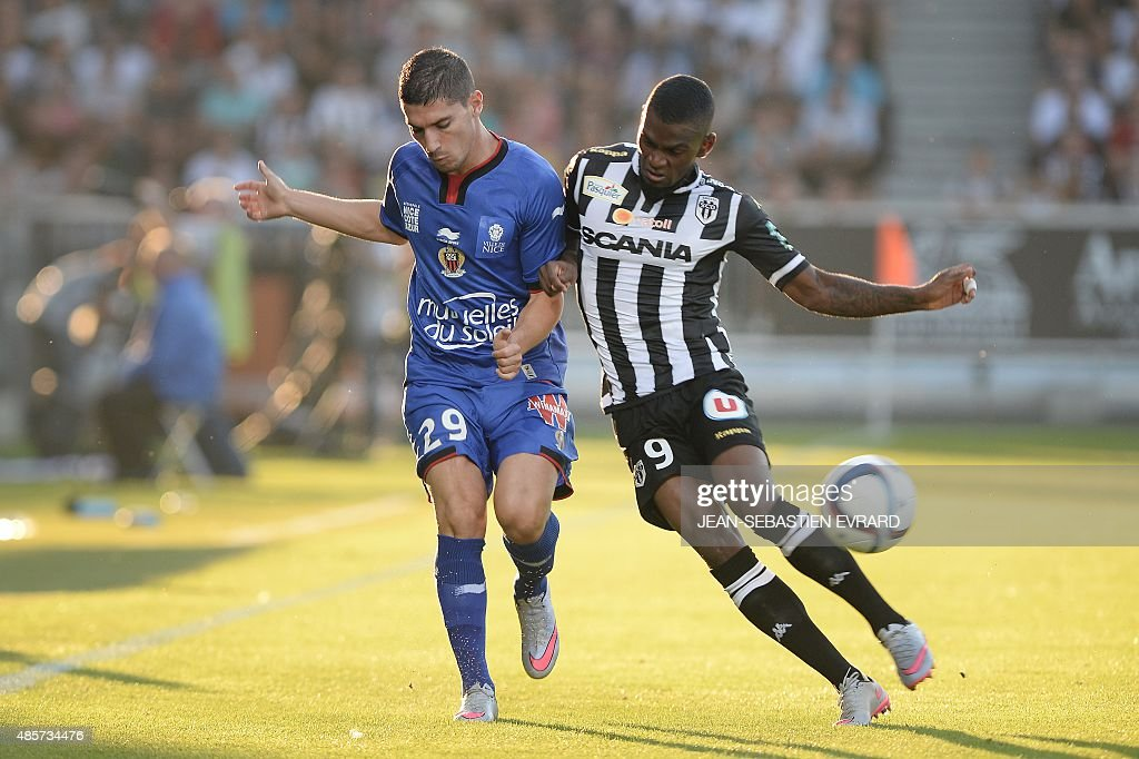 Nice's French forward Jeremy Pied vies with Angers' Guinean midfielder Abdoul Camara during the French L1 football match between Angers and Nice on...