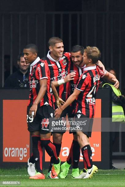 Nice's French forward Mickael Le Bihan celebrates with his teammates after scoring a goal during the French L1 Football match between OGC Nice and AS...