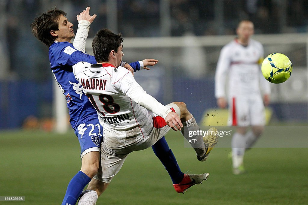 Nice's French forward Neal Maupay (R) vies for the ball with Bastia's Algerian defender Fethi Harek during the French L1 football match Bastiavs Nice in the Armand Cesari stadium in Bastia, Corsica, on February 16, 2013.