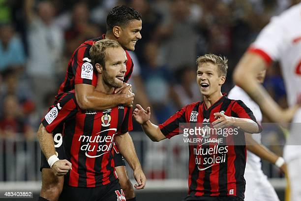 Nice's French forward Valere Germain celebrates with Nice's French forward Hatem Ben Arfa and Nice's French midfielder Vincent Koziello after scoring...