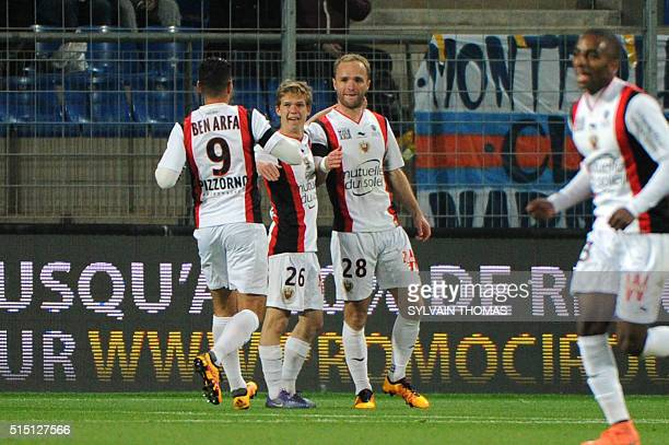 Nice's french forward Valere Germain celebrates with teammates after scoring a goal during the French L1 football match between Montpellier and Nice...