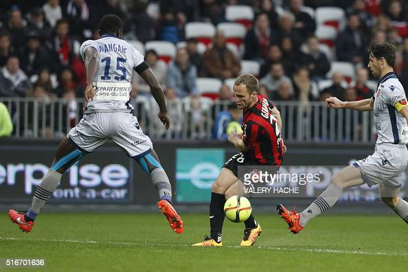 Nice's French forward Valere Germain challenges Ajaccio's French Senegalese defender Kader Mangane and French defender Jeremie Brechet during the...