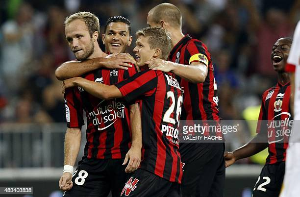 Nice's French forward Valere Germain is congratulated by teammates after scoring a goal during the French L1 football match between Nice and Monaco...