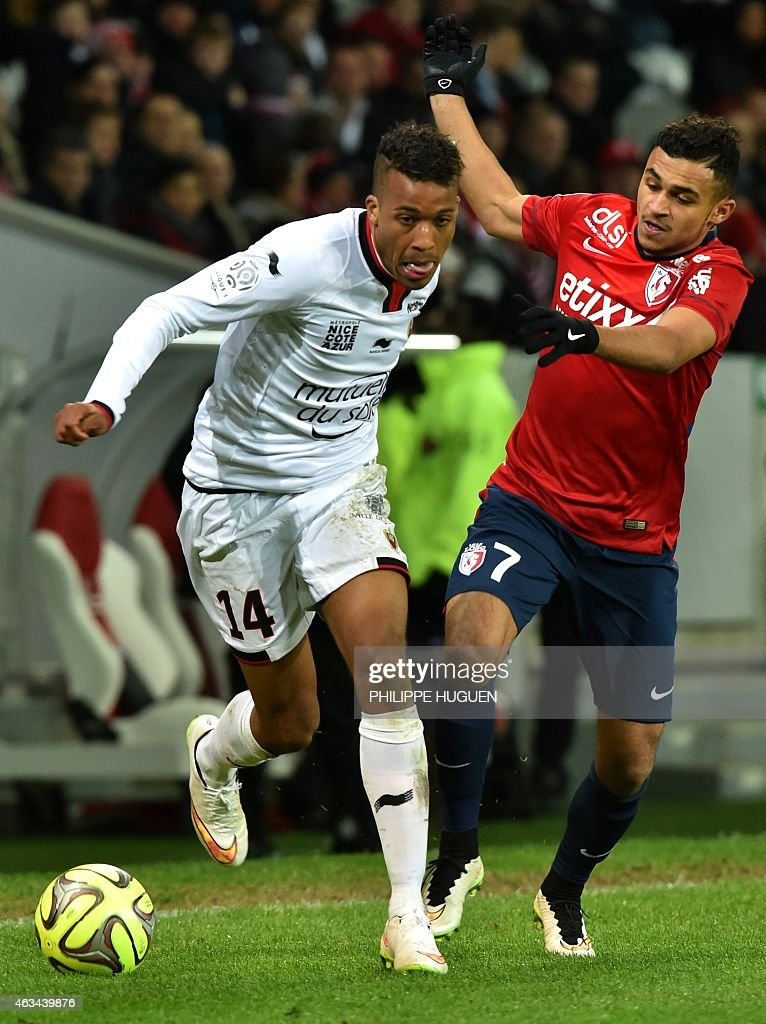 Nice's French midfielder Alassane Plea (L) vies for the ball with Lille's French midfielder Sofiane Boufal during the French L1 football match between Lille (LOSC) and Nice (OGCN) on February 14, 2015 at the Pierre Mauroy Stadium in Villeneuve d'Ascq, northern France.