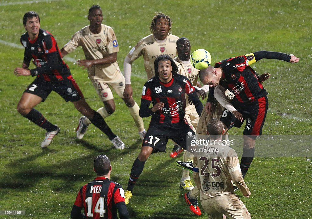 Nice's French midfielder Didier Digard (R) heads the ball during the French L1 football match between Nice (OGCN) and Valenciennes (VAFC), on January 13, 2013, at the Ray stadium in Nice, southeastern France. AFP PHOTO / VALERY HACHE