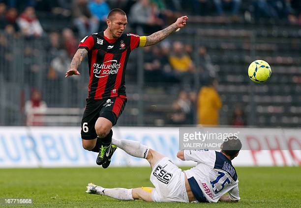 Nice's French midfielder Didier Digard vies with Troyes' French defender Florian Jarjat during a French L1 football match between Nice and Troyes on...