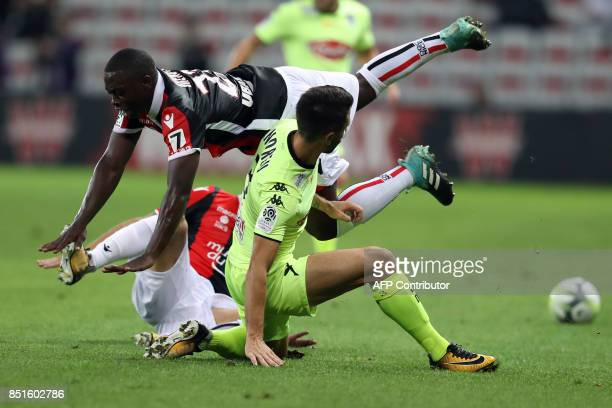 Nice's French midfielder Nampalys Mendy vies with Angers' French defender Yoann Andreu during the French L1 football match Nice vs Angers on...