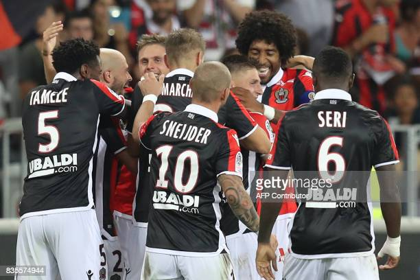 Nice's French midfielder Remi Walter celebrates with his teammates after scoring a goal during the French L1 football match Nice vs Guingamp on...