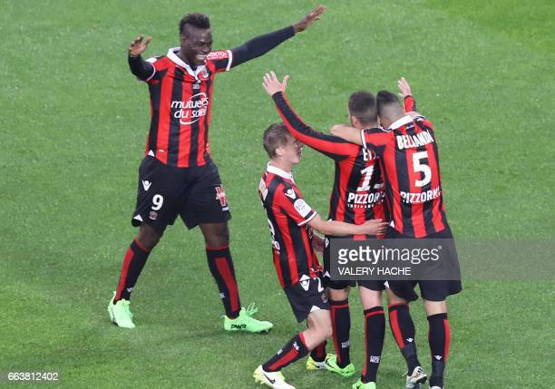 Nice's French midfielder Valentin Eysseric celebrates with his teammates after scoring during the French L1 football match Nice vs Bordeaux on April...